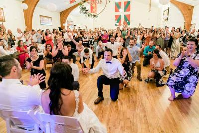 Friends and guests in general paying tribute to Jon and Krystle Aramburu on their wedding day celebrating a the Boise Basque Center
