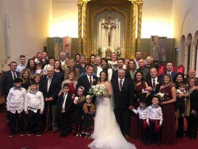 The newlyweds along with the Alfaro family and friends