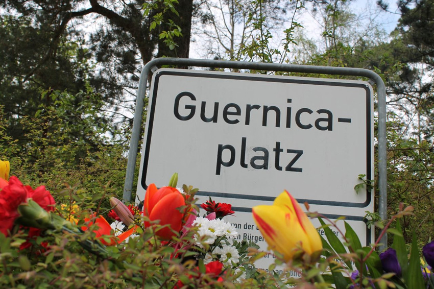 Flowers and poems in the Gernika Plaza in Berlin