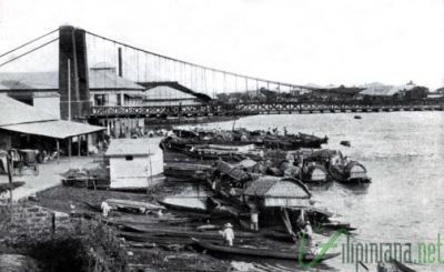 Hanging Bride. The 'Puente Colgante' suspension bridge once hung over the Pasig river and was known to be the first of its kind in East Asia (1852). Photo courtesy of Filipiniana.net.