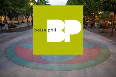 Boise Phil concert announcement with an image of a huge Lauburu on the pavement of Boise's Basque Block